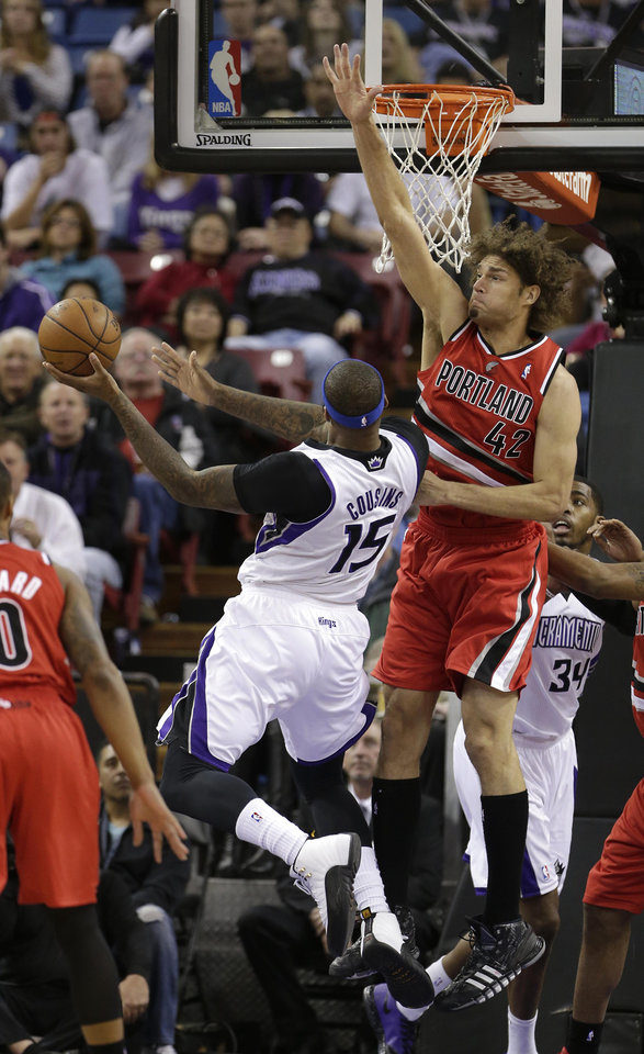Photo - Portland Trail Blazers center Robin Lopez, right, tries to block the shot of Sacramento Kings center DeMarcus Cousins, left, during the first quarter of an NBA basketball game in Sacramento, Calif., Tuesday, Jan. 7, 2014. (AP Photo/Rich Pedroncelli)