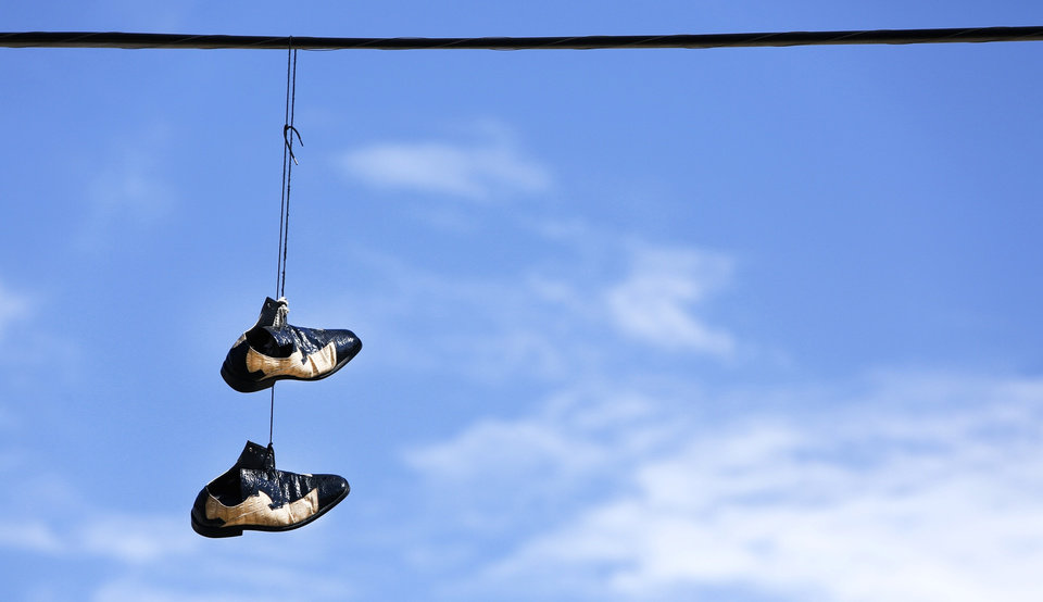 A pair of shoes hangs from utility lines near NW 12th and Hudson in Oklahoma City , Friday April 1, 2013. Photo By Steve Gooch, The Oklahoman ORG XMIT: OKC1303121532440650