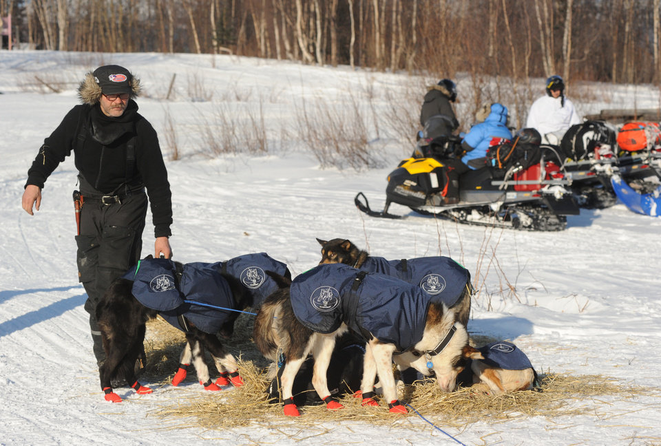 Photo - Robert Sorlie prepares to leave the Yukon River village of Kaltag during the 2014 Iditarod Trail Sled Dog Race on Saturday, March 8, 2014. (AP Photo/The Anchorage Daily News, Bob Hallinen)