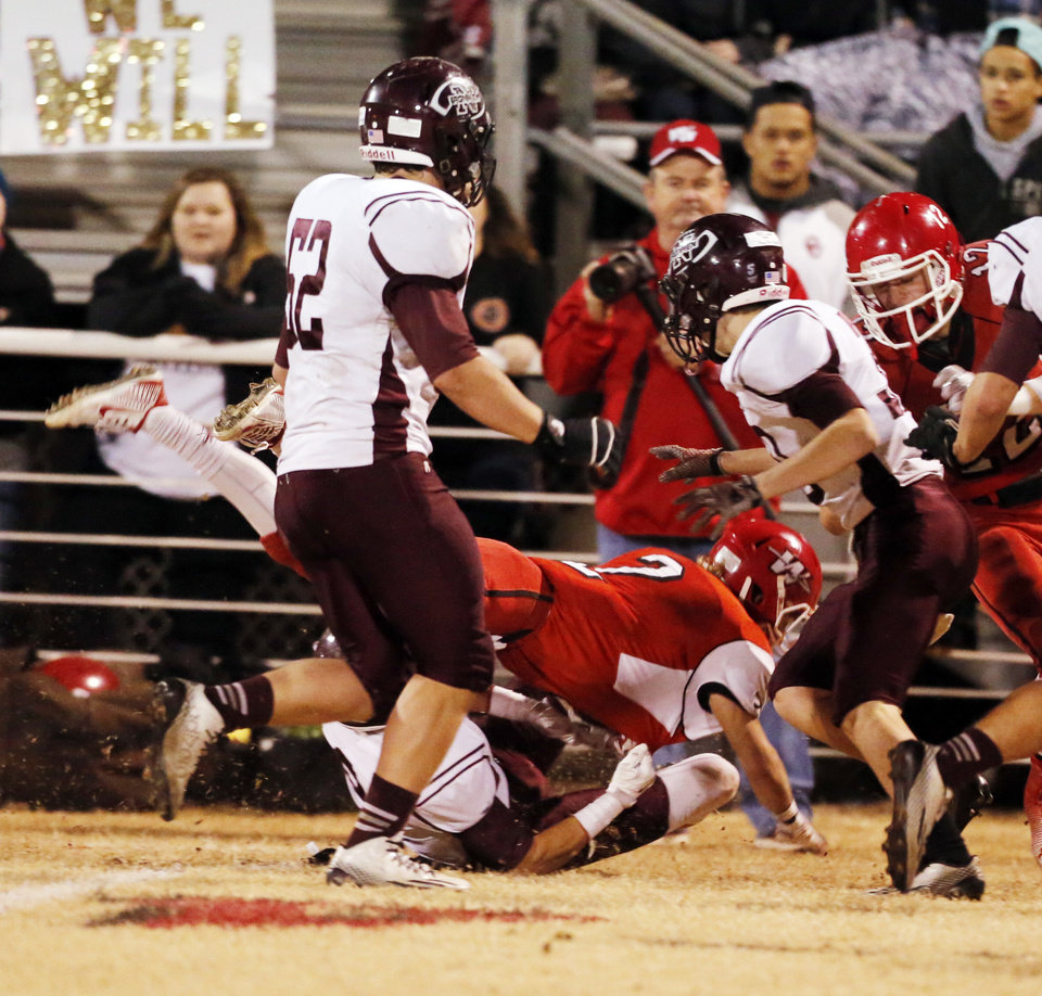 Photo - Washington player Brady Kulbeth is injured  on a second quarter play as the Nowata Ironmen play the Washington Warriors in high school football on Friday, Nov. 28, 2014 in Washington, Okla. Photo by Steve Sisney, The Oklahoman