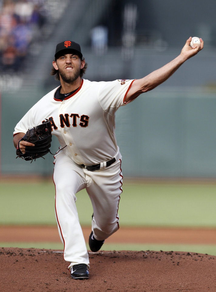 Photo - San Francisco Giants starting pitcher Madison Bumgarner throws to the Chicago Cubs during the first inning of a baseball game on Saturday, July 27, 2013, in San Francisco. (AP Photo/Tony Avelar)
