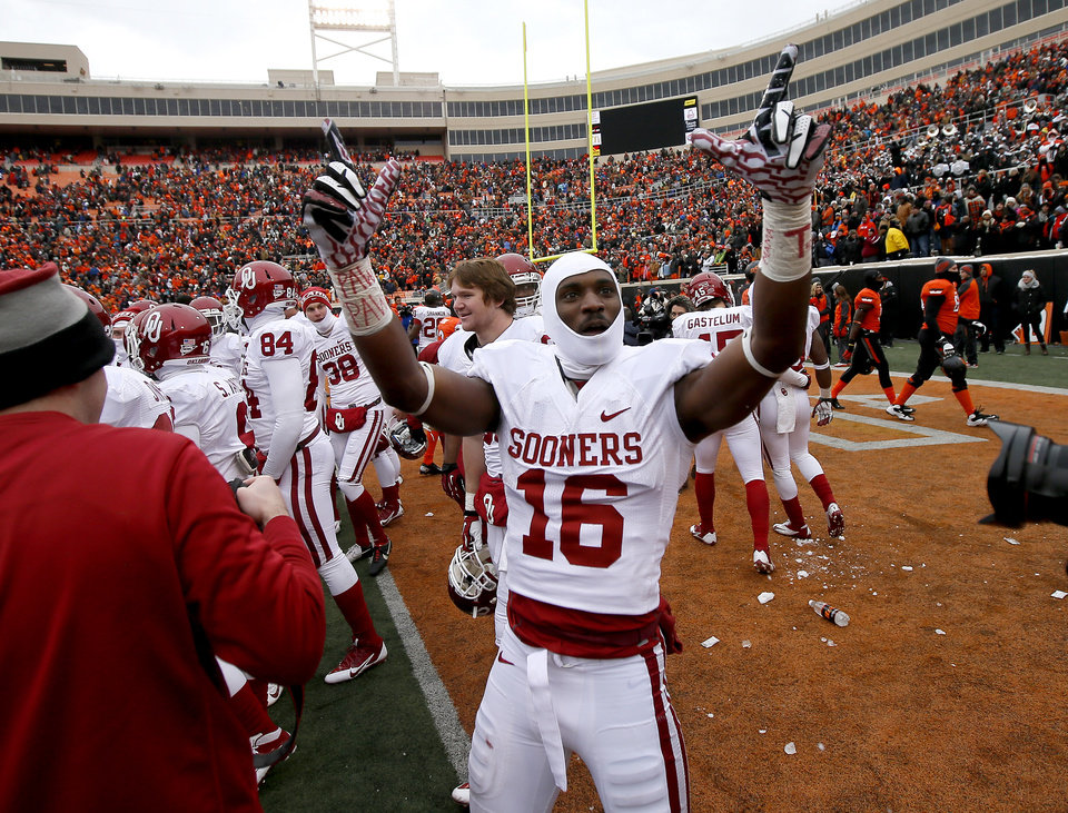 Oklahoma's Jaz Reynolds (16) celebrates after the Bedlam college football game between the Oklahoma State University Cowboys (OSU) and the University of Oklahoma Sooners (OU) at Boone Pickens Stadium in Stillwater, Okla., Saturday, Dec. 7, 2013. Oklahoma won 33-24. Photo by Bryan Terry, The Oklahoman