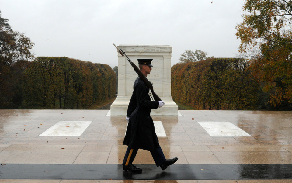 "CLARIFIES WHEN PHOTO WAS MADE - This handout photo taken in the morning before the cemetery was closed for the day and provided by the U.S. Army, shows Spc. Brett Hyde, Tomb Sentinel, 3d U.S. Infantry Regiment (The Old Guard), keeping guard over the Tomb of the Unknown Soldier as Hurricane Sandy approaches, at Arlington National Cemetery, Va., Monday, Oct. 29, 2012.   Just like the Sentinel's Creed says ""Through the years of diligence and praise and the discomfort of the elements, I will walk my tour in humble reverence to the best of my ability.""    (AP Photo/U.S. Army, Sgt. Jose A. Torres, Jr.) ORG XMIT: VARL101"