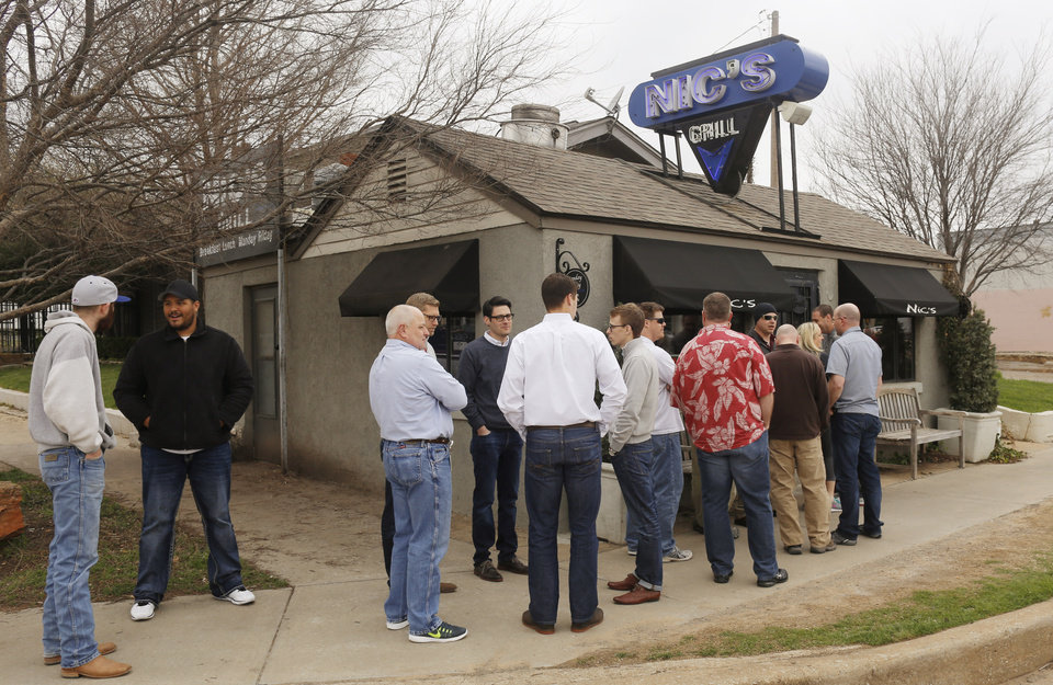 Photo - Customers wait in line outdoors at Nic's Grill, Friday, March 27, 2015. Photo by Doug Hoke, The Oklahoman
