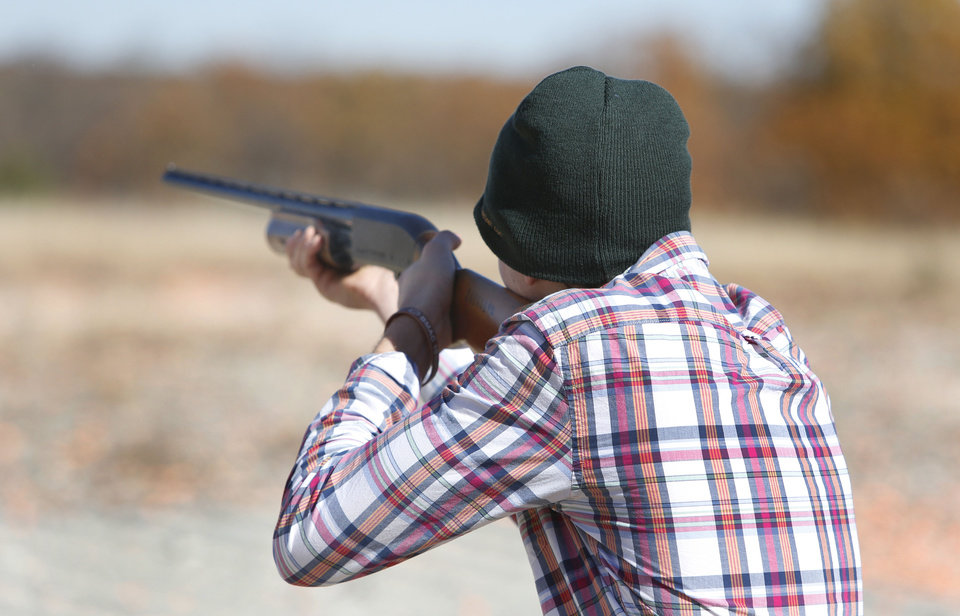 Photo - Perry High School senior Cooper Skluzacek competes in the FFA State Shooting Championship at the Oklahoma City Gun Club, Wednesday November 13, 2013. Photo By Steve Gooch, The Oklahoman