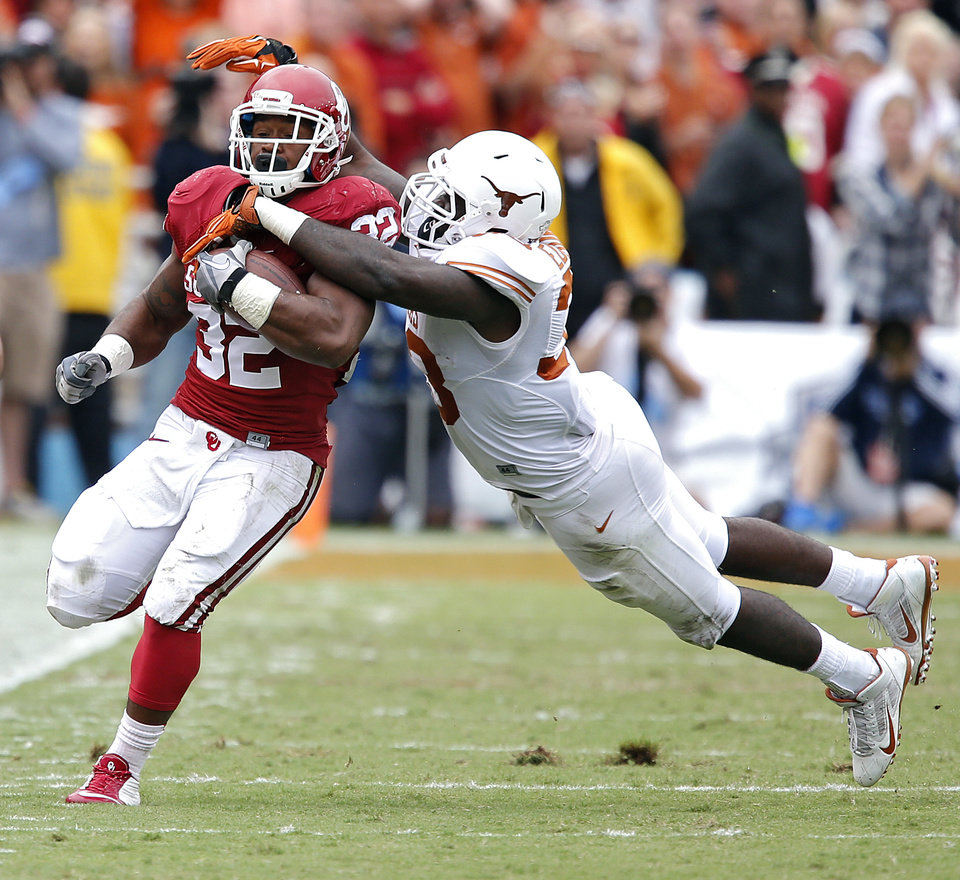 Photo - Oklahoma's Samaje Perine (32) runs past Texas' Steve Edmond (33) during the college football game between the University of Oklahoma Sooners (OU) and the University of Texas Longhorns (UT) during the Red River Showdown at the Cotton bowl in Dallas, Texas on Saturday, Oct. 11, 2014. Photo by Chris Landsberger, The Oklahoman