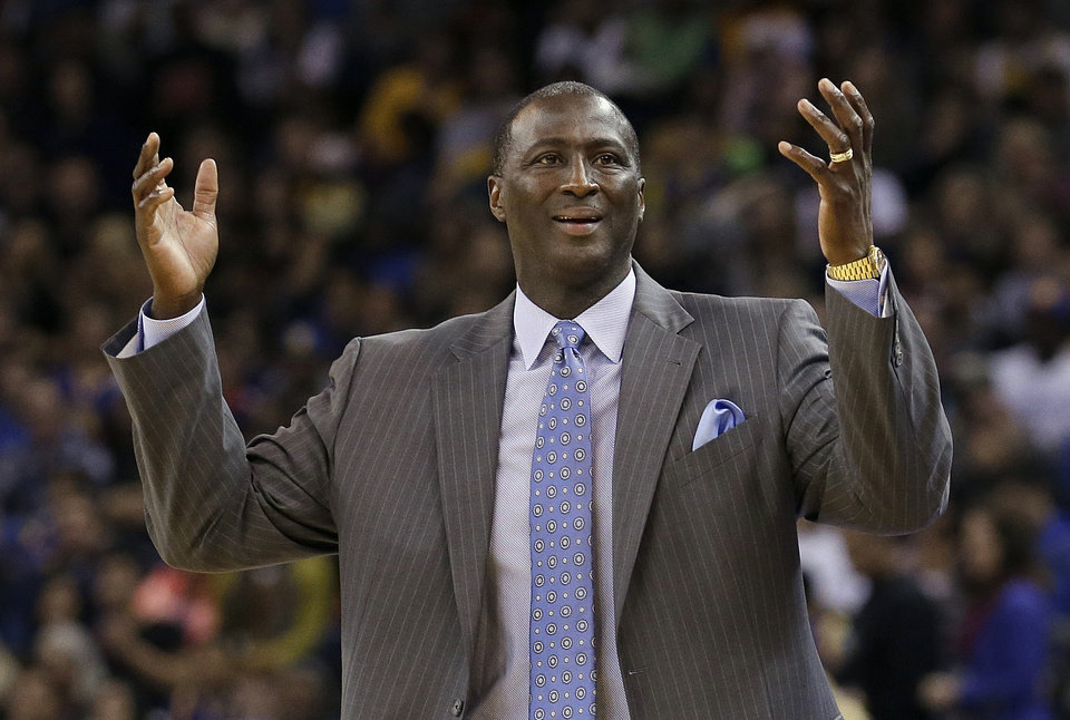 Photo - Utah Jazz head coach Tyrone Corbin gestures after an official's call during the second quarter of an NBA basketball game against the Golden State Warriors in Oakland, Calif., Saturday, Nov. 16, 2013. (AP Photo/Jeff Chiu)