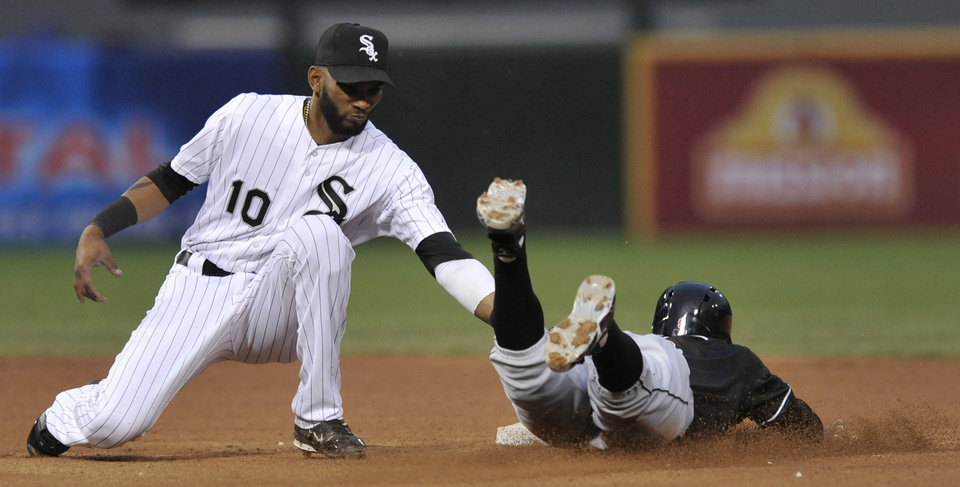 Chicago White Sox shortstop Alexei Ramirez (10) tags out Miami Marlins' Juan Pierre at second base after Pierre tried to steal the base during the sixth inning of a baseball game in Chicago, Saturday, May 25, 2013. (AP Photo/Paul Beaty)