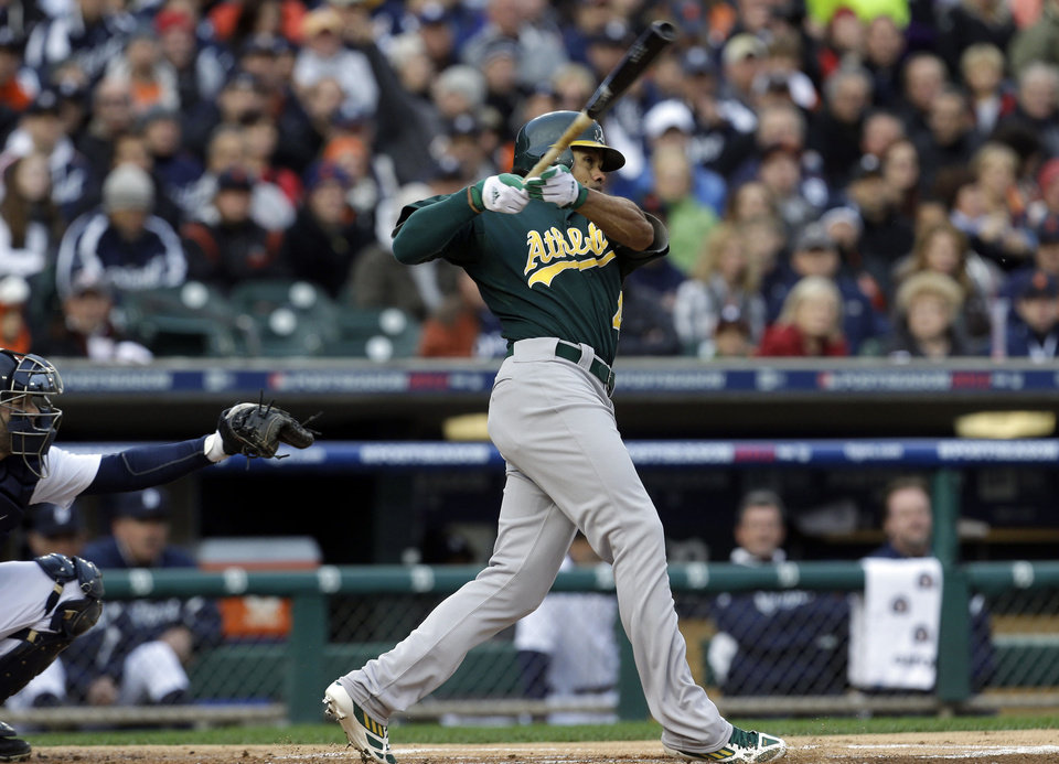Photo -   Oakland Athletics' Coco Crisp hits a home run during the first inning of Game 1 of the American League division baseball series against the Detroit Tigers, Saturday, Oct. 6, 2012, in Detroit. (AP Photo/Paul Sancya)