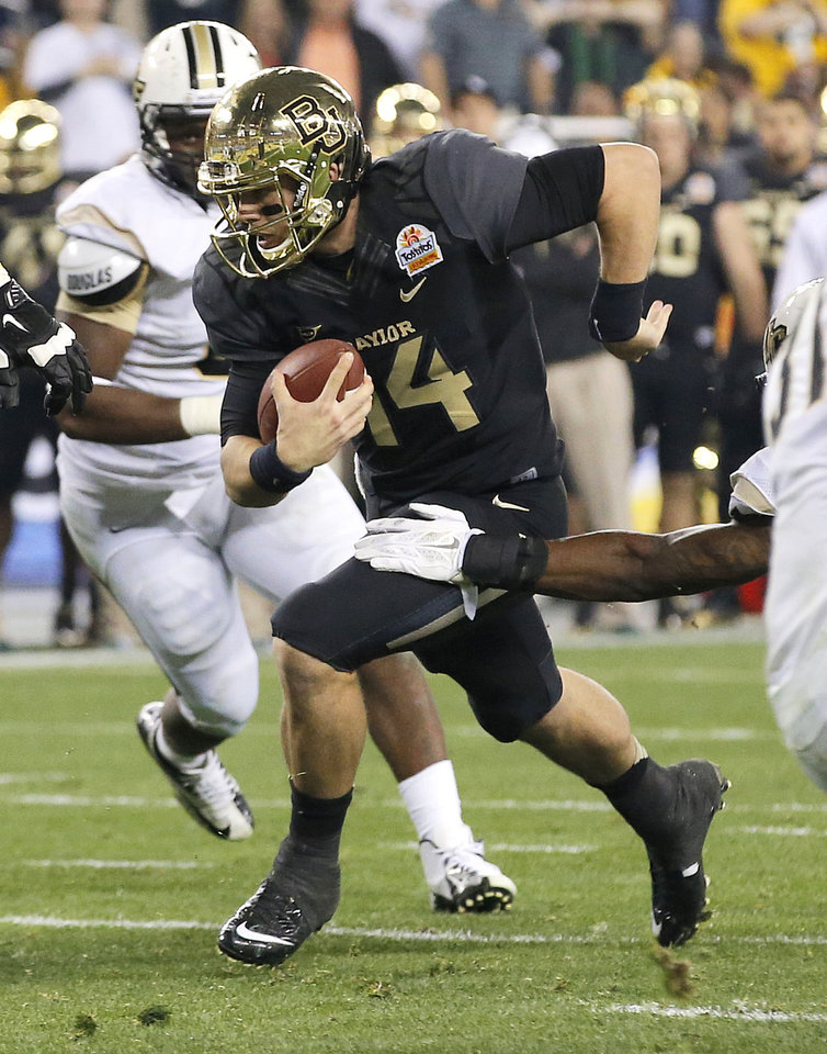 Photo - Baylor quarterback Bryce Petty (14) runs in for a touchdown against Central Florida during the second half of the Fiesta Bowl NCAA college football game, Wednesday, Jan. 1, 2014, in Glendale, Ariz. (AP Photo/Ross D. Franklin)
