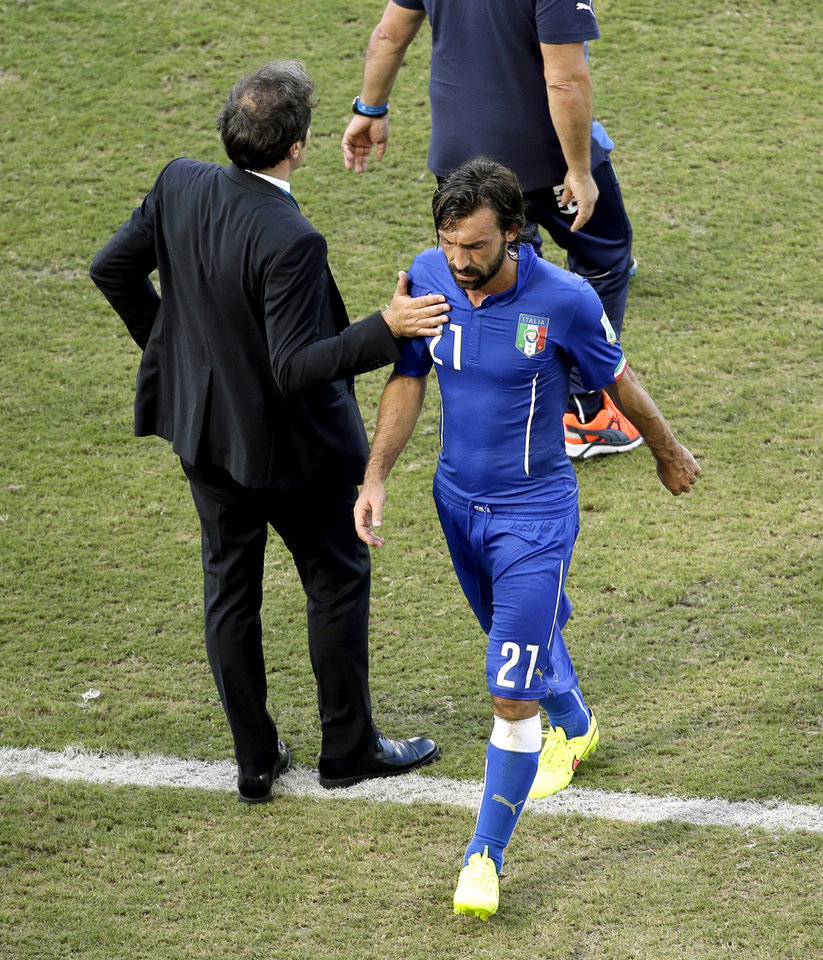 Photo - Italy's Andrea Pirlo leaves the pitch following the group D World Cup soccer match between Italy and Uruguay at the Arena das Dunas in Natal, Brazil, Tuesday, June 24, 2014. Uruguay won 1-0. (AP Photo/Hassan Ammar)