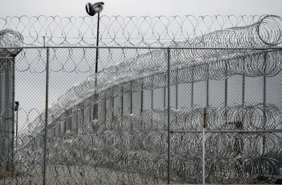 PRISON: Security fence is pictured at the Joseph Harp Correctional Center in Lexington, Okla., on Friday, January 4, 2008. BY SARAH PHIPPS, THE OKLAHOMAN