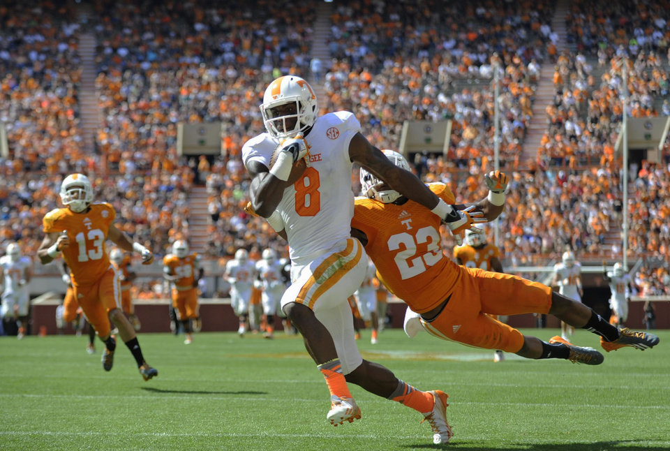 Photo - Tennessee wide receiver Marquez North (8) runs for a touchdown past Tennessee defensive back Cameron Sutton (23) during the first half of the Orange and White spring NCAA college football game at Neyland Stadium in Knoxville, Tenn., Saturday, April 12, 2014. (AP Photo/Knoxville News Sentinel, Adam Lau)