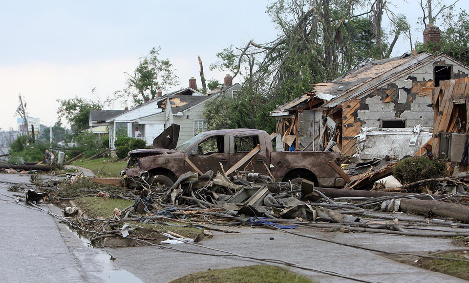 Photo - Houses and vehicles are destroyed after a tornado ripped through Tuscaloosa, Ala. Wednesday, April 27, 2011.  A wave of severe storms laced with tornadoes strafed the South on Wednesday, killing at least 16 people around the region and splintering buildings across swaths of an Alabama university town. (AP Photo/The Tuscaloosa News, Michelle Lepianka Carter)
