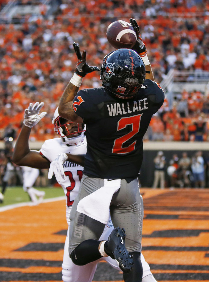 Photo - Oklahoma State's Tylan Wallace (2) makes a touchdown catch as South Alabama's Darian Mills (21) defends in the first quarter during a college football game between Oklahoma State (OSU) and South Alabama at Boone Pickens Stadium in Stillwater, Okla., Saturday, Sept. 8, 2018. Photo by Nate Billings, The Oklahoman
