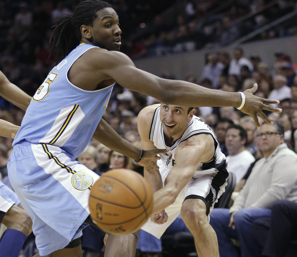 Photo - San Antonio Spurs' Manu Ginobili, right, of Argentina, passes the ball under the arm of Denver Nuggets' Kenneth Faried, left, during the first half of an NBA basketball game, Wednesday, March 27, 2013, in San Antonio. (AP Photo/Eric Gay)