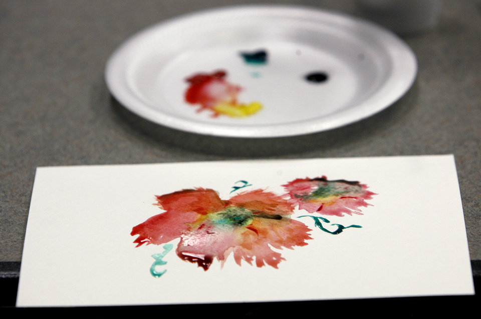 Photo - ART / ARTWORK: The students were allowed to choose from a variety of paint colors to create their art during a Chinese Brush Painting class at the Edmond Library in Edmond, Okla. July 14, 2009.  Photo by Ashley McKee, The Oklahoman   ORG XMIT: KOD