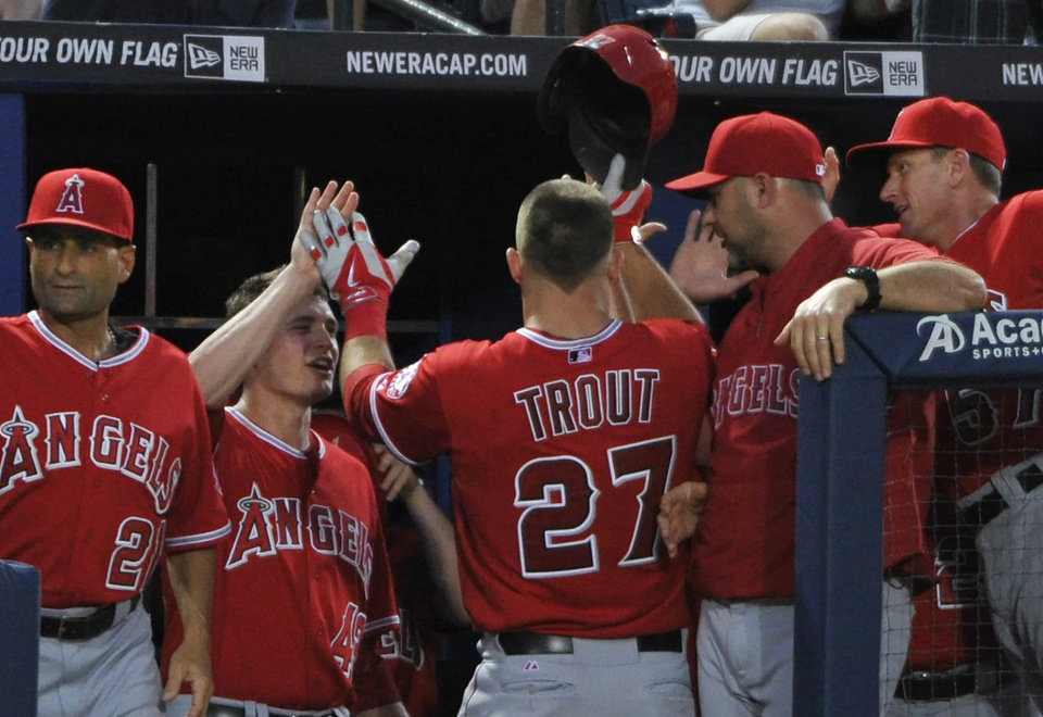 Photo - Los Angeles Angels' Mike Trout (27) celebrates with teammates after his home run against the Atlanta Braves during the sixth inning of a baseball game on Saturday, June 14, 2014, in Atlanta. (AP Photo/David Tulis)