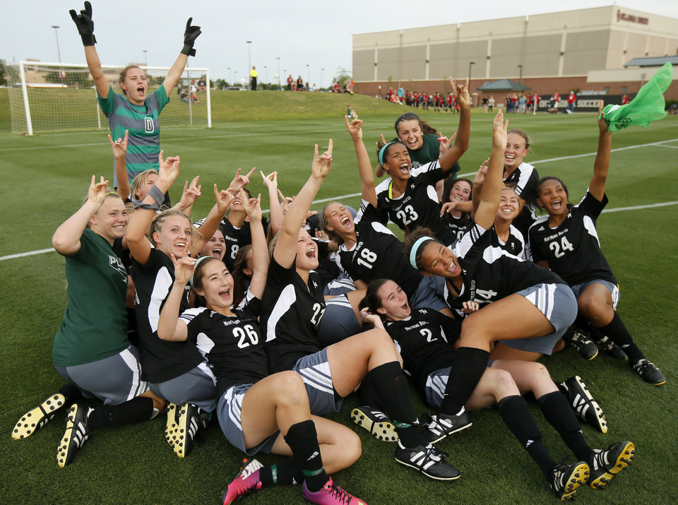 Photo - Norman North celebrates after winning the Class 6A girls soccer championship between Edmond Memorial and Norman North in Norman, Okla., Friday, May 16, 2014. Photo by Bryan Terry, The Oklahoman