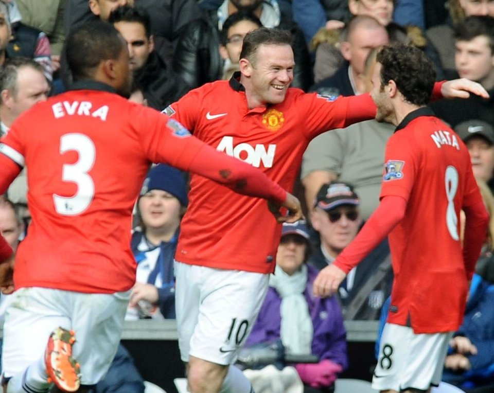 Photo - Manchester United's Wayne Rooney celebrates with Juan mata, right, and Patrice Evra after scoring against West Brom during the English Premier League soccer match between West Bromwich Albion and Manchester United at The Hawthorns Stadium in West Bromwich, England, Saturday, March 8, 2014.  (AP Photo/Rui Vieira)