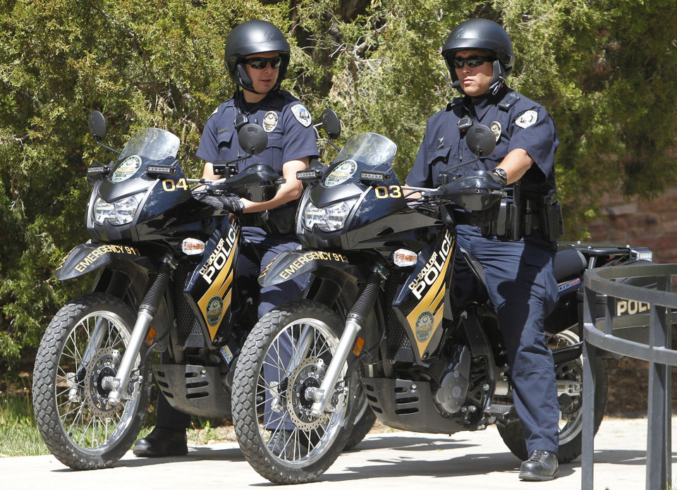 Photo -   University Police on motorcycles stand watch at the University of Colorado in Boulder, Colo., on Friday, April 20, 2012. The university closed the campus to prohibit an annual 420 marijuana smoke out. (AP Photo/Ed Andrieski)