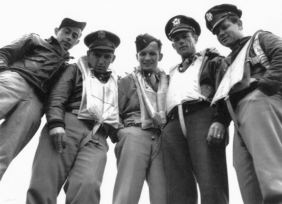 This undated picture made by a soldier in the U.S. Army shows 2nd Lt. David C. Cox, center, with fellow survivors from the May 17, 1943 mission where Cox was awarded the Distinguished Flying Cross for helping to get his burning plane back to England from a raid that cost the lives of half his 10-man crew. A gold aviator's ring was a present from his parents, but as a starving prisoner of war in Germany, he gave it up - in exchange for a couple of chocolate bars. He'd never see the ring again, but it did not disappear. (AP Photo/U.S. Army)