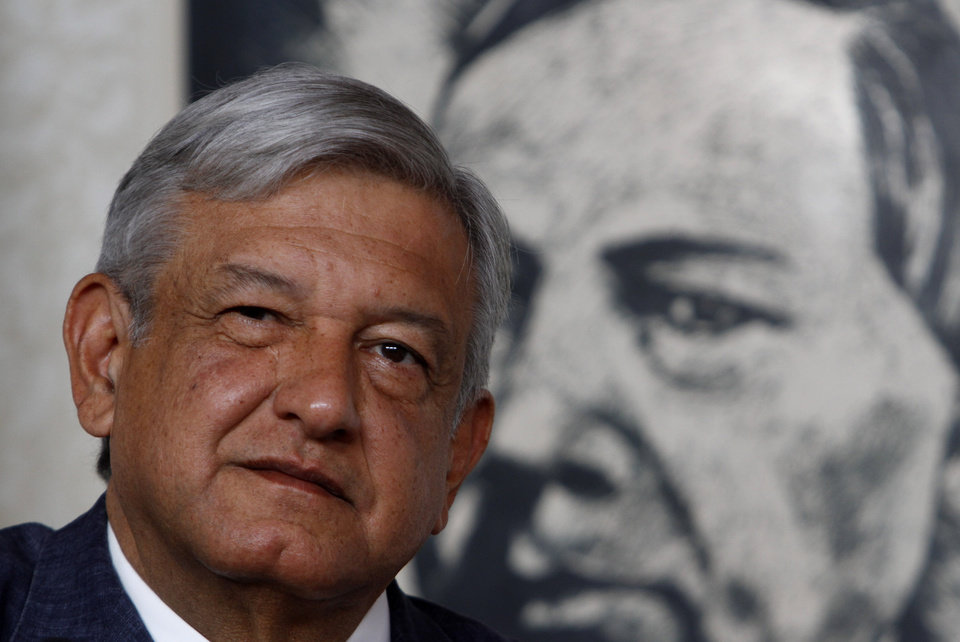 Photo -   FILE - In this Friday, April 13, 2012 file photo, Manuel Lopez Obrador, presidential candidate for the Democratic Revolution Party, PRD, is backdropped by a painting of Benito Juarez, Mexico's first president of Indian descent and national hero, while speaking at a news conference in Mexico City. For a man whose anger and inflexibility may have cost him his dreams of the presidency, leftist candidate Andres Manuel Lopez Obrador is surprisingly calm and friendly on the campaign trail. Mexico will hold presidential elections on July 1, 2012. (AP Photo/Marco Ugarte, File)