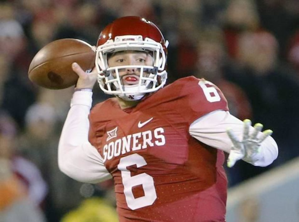 Photo - Oklahoma quarterback Baker Mayfield is not afraid to answer questions that might start controversy. (AP Photo)