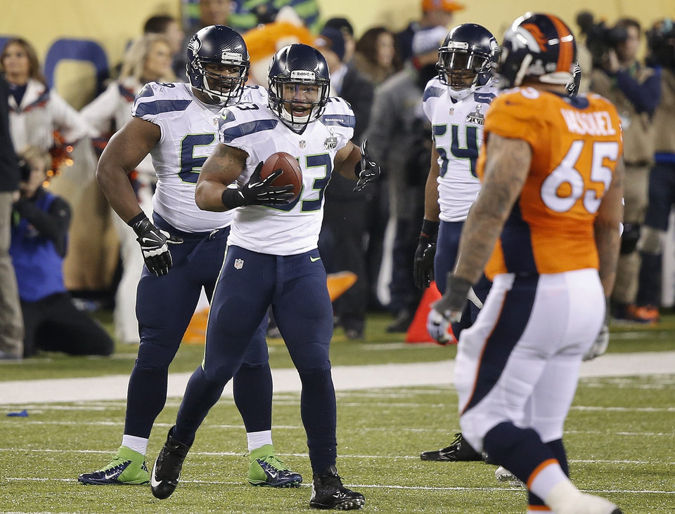 Photo - Seattle Seahawks' linebacker Malcolm Smith (53) reacts after recovering a fumble by Denver Broncos wide receiver Demaryius Thomas during the second half of the NFL Super Bowl XLVIII football game, Sunday, Feb. 2, 2014, in East Rutherford, N.J. (AP Photo/Kathy Willens)