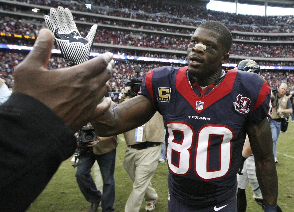 Photo -   Houston Texans wide receiver Andre Johnson is congratulated as he leaves the field after an NFL football game against the Jacksonville Jaguars Sunday, Nov. 18, 2012, in Houston. Johnson scored the winning touchdown in their 43-37 overtime win. (AP Photo/Patric Schneider)