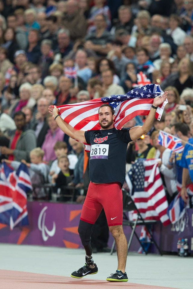 Photo - U.S. Paralympic athlete Jeremy Campbell celebrates at the 2012 Paralympic Games in London after winning a gold medal in the men's F44 discus throw.  PHOTO PROVIDED  Joe Kusumoto - PROVIDED