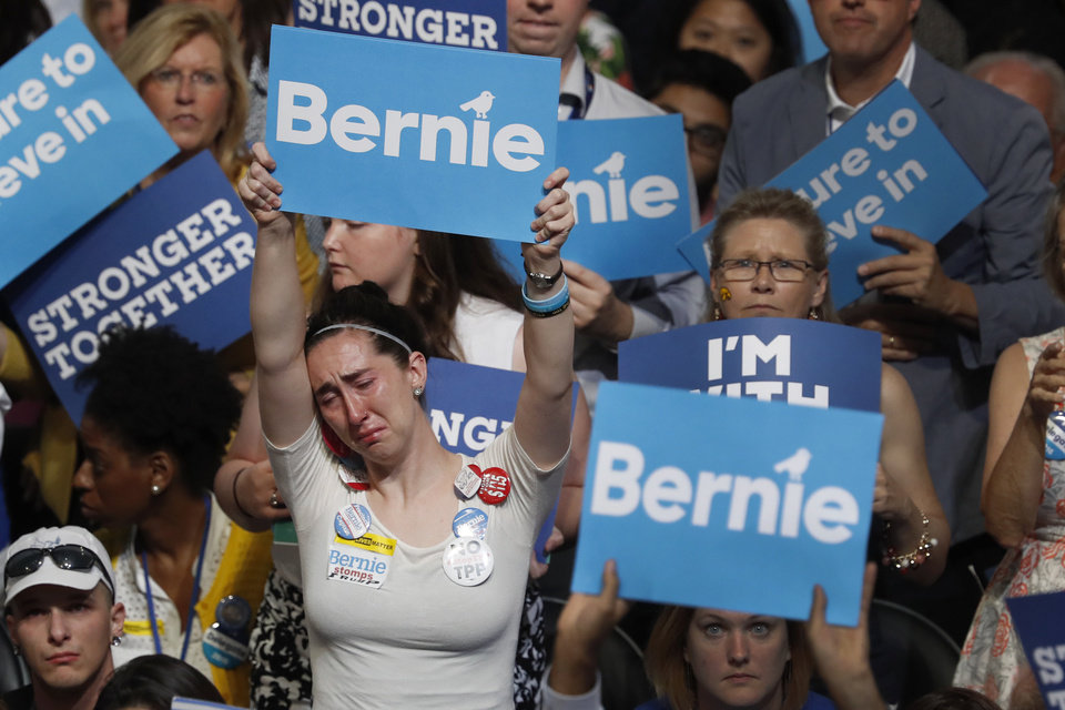 Photo - A disappointed supporter for Former Democratic presidential candidate, Sen. Bernie Sanders, I-Vt., holds up her sign during the first day of the Democratic National Convention in Philadelphia , Monday, July 25, 2016. (AP Photo/Mary Altaffer)