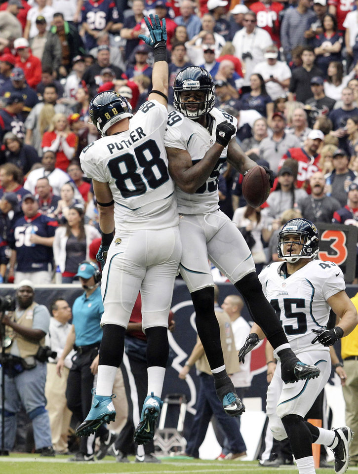 Photo -   Jacksonville Jaguars' Zach Potter (88) and Marcedes Lewis (89) celebrate a touchdown during the third quarter of an NFL football game against the Houston Texans Sunday, Nov. 18, 2012, in Houston. (AP Photo/Patric Schneider)