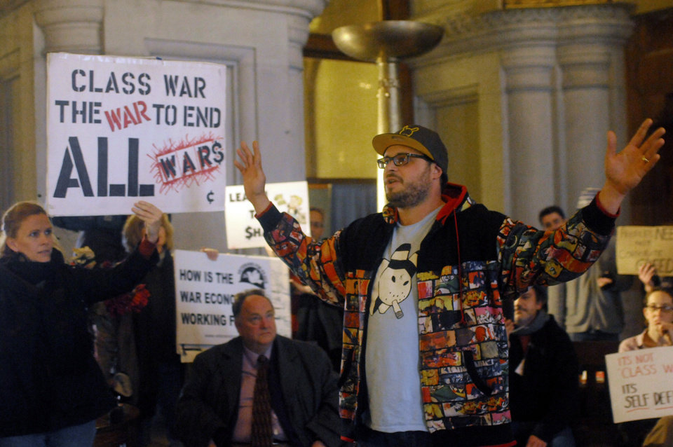 Michael Fisk, a first year law student at Albany Law School speaks to demonstrators supporting the Occupy Wall Street movement during a rally in the War Room inside the state Capitol in Albany, N.Y., Thursday, Oct. 27, 2011.  Several speakers criticized Gov. Andrew Cuomo for blocking a bill that would tax New Yorkers making over $1 million a year at a higher rate while cutting aid to schools, colleges and the poor.  Cuomo, who was in New York City, had no immediate comment Thursday.  (AP Photo/Hans Pennink) ORG XMIT: NYHP102