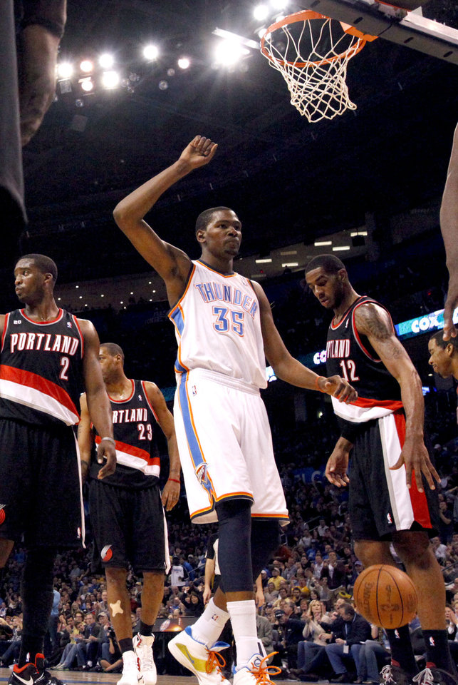 Photo - Oklahoma City's Kevin Durant (35) celebrates a Thunder basket Oklahoma City Thunder and the Portland Trailblazers, Sunday, March 27, 2011, at the Oklahoma City Arena. Photo by Sarah Phipps, The Oklahoman