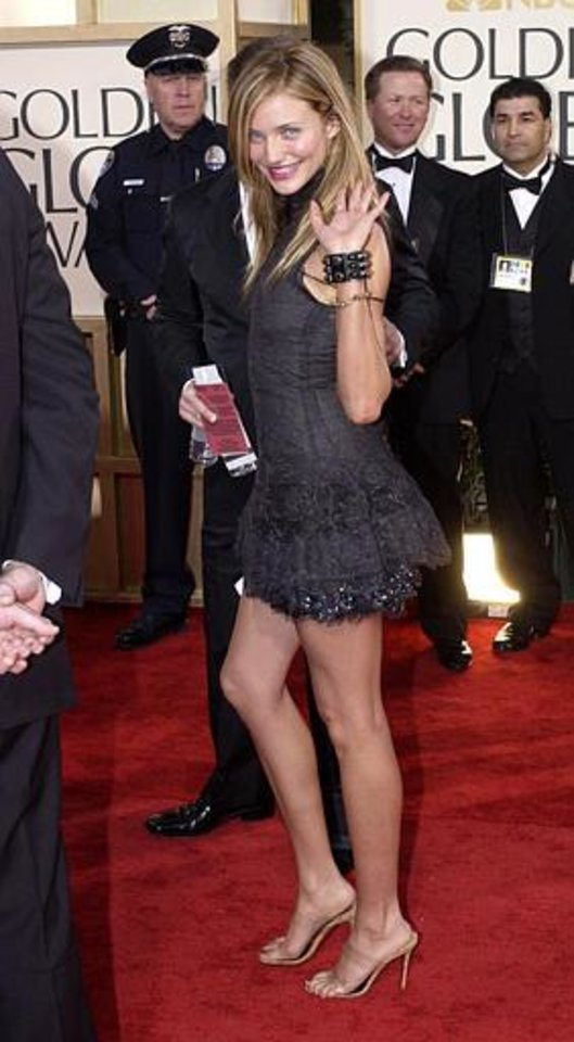"""Cameron Diaz, nominated for best performance by an actress in a supporting role in a motion picture for her work in """"Gangs of New York,"""" waves as she arrives for the 60th Annual Golden Globe Awards, in Beverly Hills, Calif., Sunday, Jan. 19, 2003. (AP Photo/Mark J. Terrill)"""