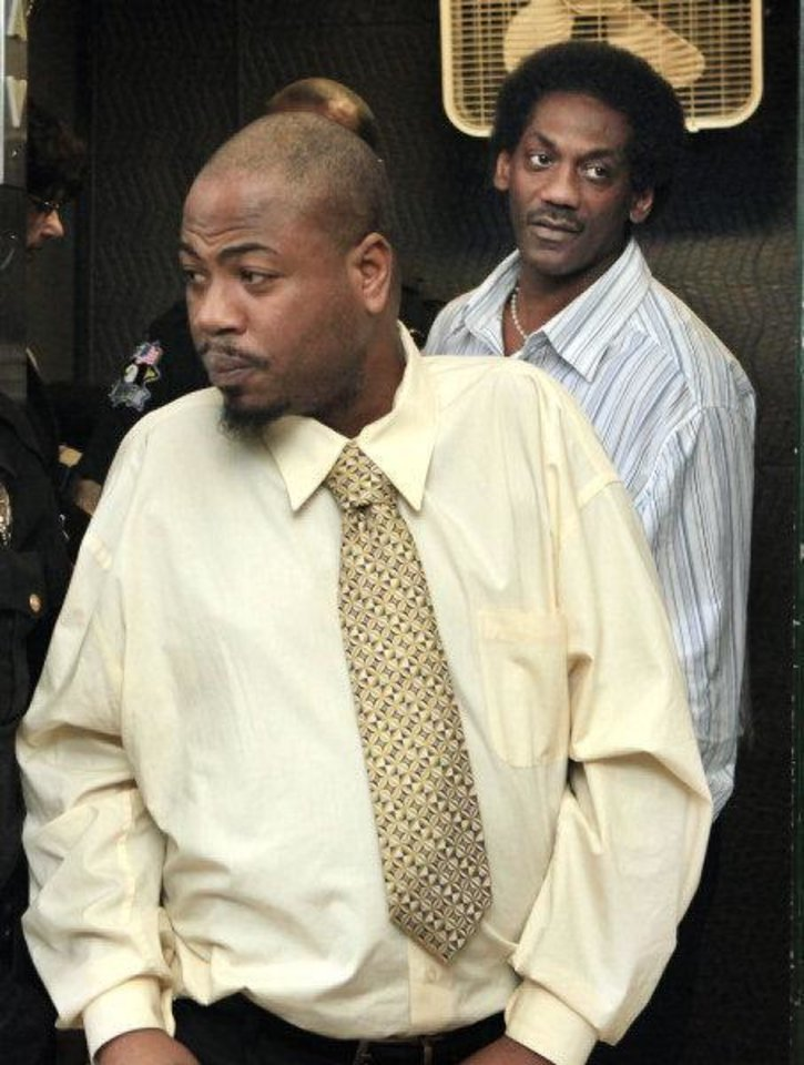 Emanuel D. Mitchell, left, and Anthony D. Morrison arrive Monday for the last day of their trial. Mitchell later attacked District Attorney David Prater inside the courtroom.  <strong>PAUL B. SOUTHERLAND - PAUL B. SOUTHERLAND</strong>