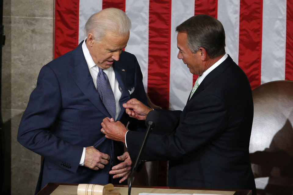 Photo - House Speaker John Boehner of Ohio adjusts Vice President Joe Biden's lapels before President Barack Obama's State of the Union address on Capitol Hill in Washington, Tuesday Jan. 28, 2014. (AP Photo/Charles Dharapak)
