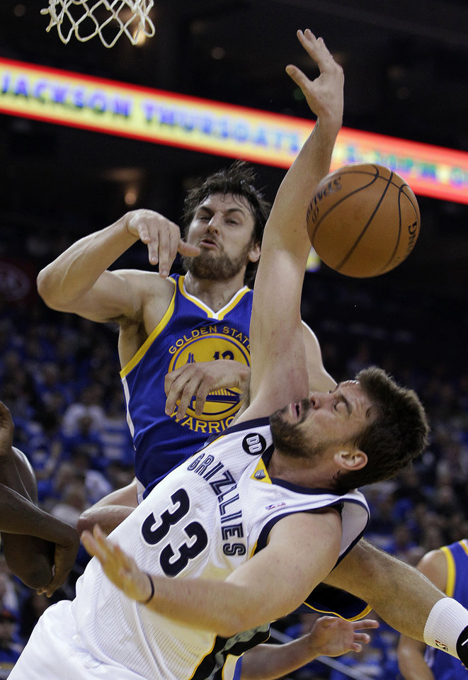 Memphis Grizzlies' Marc Gasol (33) has his shot blocked by Golden State Warriors' Andrew Bogut during the first half of an NBA basketball game Friday, Nov. 2, 2012, in Oakland, Calif. (AP Photo/Ben Margot)