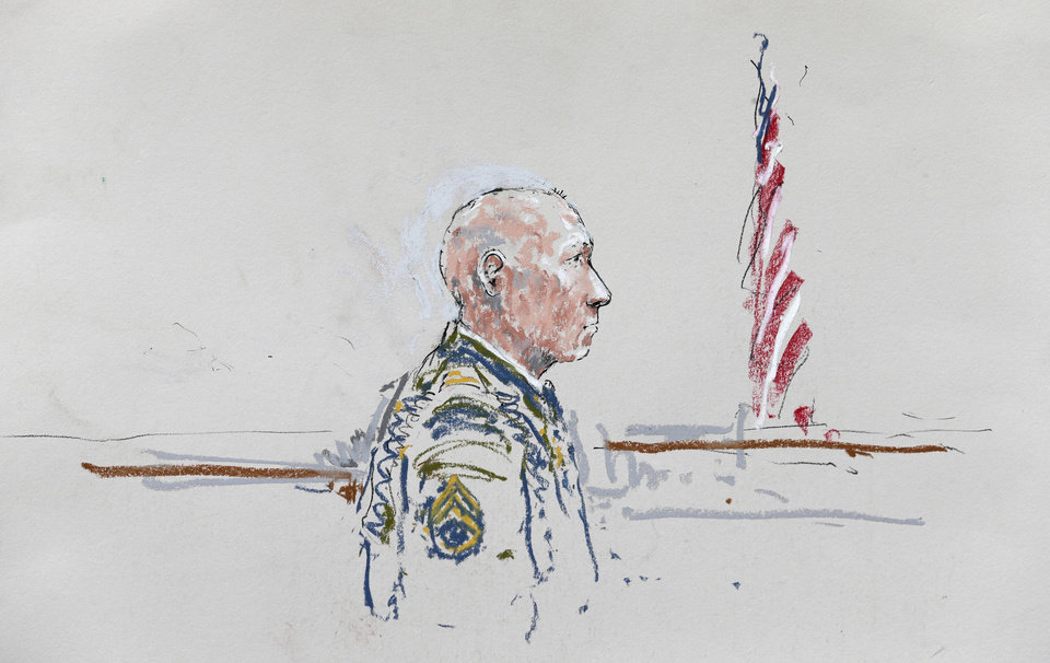 Photo - In this courtroom sketch, U.S. Army Staff Sgt. Robert Bales appears Wednesday, June 5, 2013, during a plea hearing in a military courtroom at Joint Base Lewis-McChord in Washington state. Bales is accused of 16 counts of premeditated murder and six counts of attempted murder for a pre-dawn attack on two villages in Kandahar Province in Afghanistan in March, 2012. (AP Photo/Peter Millett)