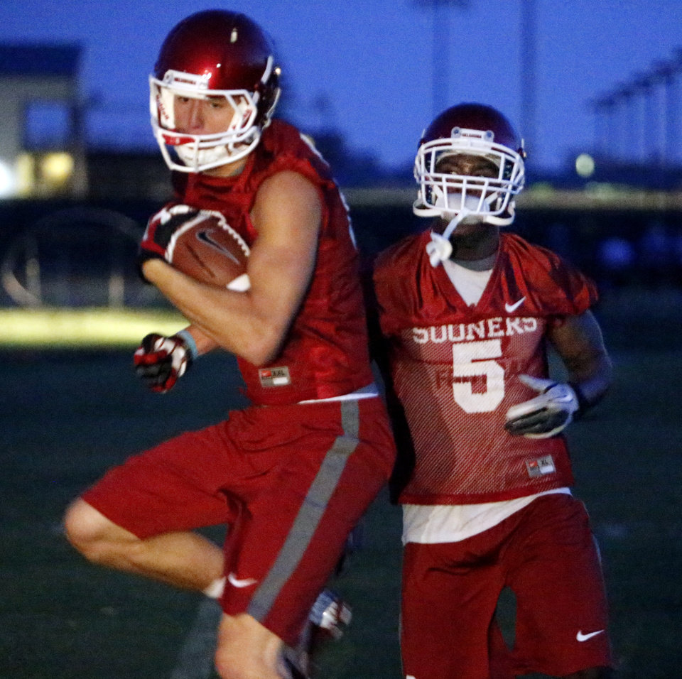 Receivers Sam Grant (81), left, and Durron Neal (5) participate in ball handling drills at pre-dawn practice for the University of Oklahoma Sooners (OU) in Norman, Okla., Friday, Aug. 2, 2013. Photo by Steve Sisney, The Oklahoman