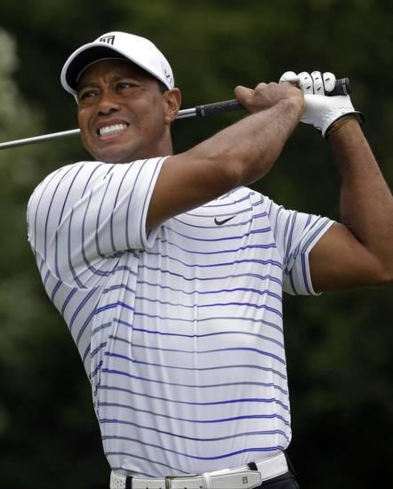 Photo -  A muscled-up Tiger Woods swings during the PGA Championship last week before missing the cut. (AP Photo)