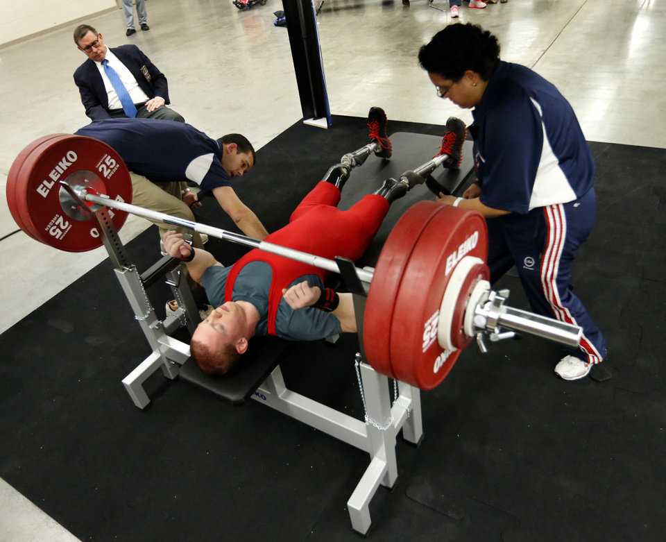 Photo - Trevor Bunch prepares to lift during the IPC Powerlifting competition during the Sports and Health Festival on Saturday, Feb. 16, 2013  in Oklahoma City, Okla. Photo by Steve Sisney, The Oklahoman