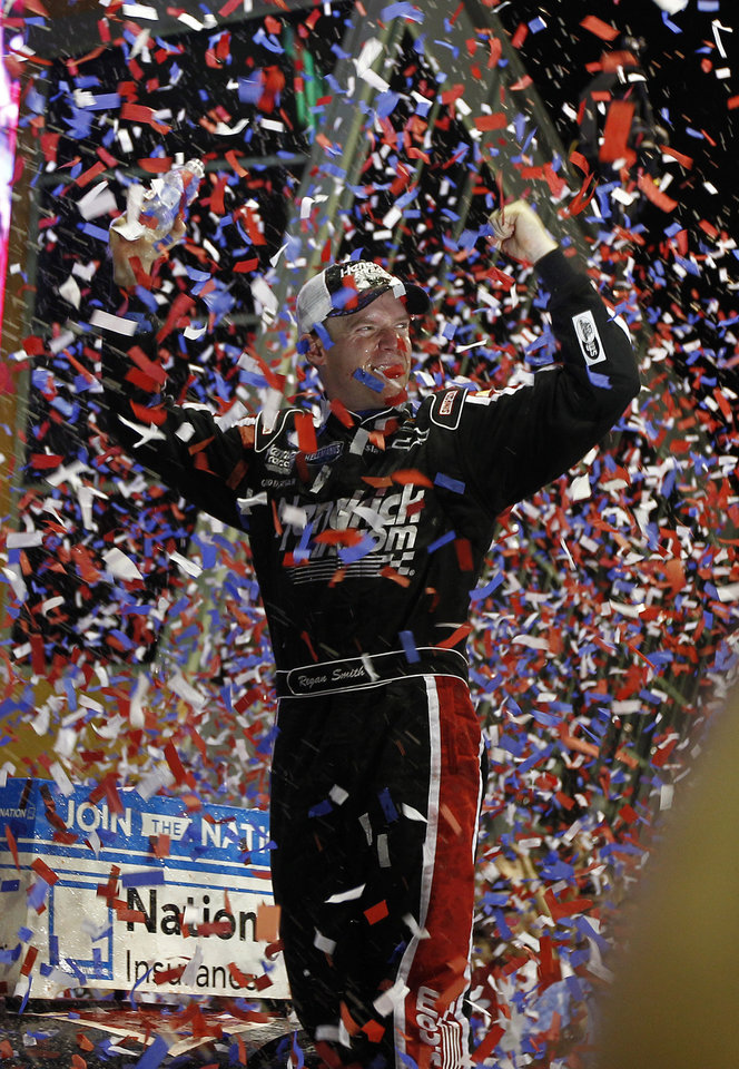 Driver Regan Smith celebrates in victory lane after winning the NASCAR Nationwide Series auto race at the Homestead-Miami Speedway in Homestead, Fla., Saturday, Nov. 17, 2012. (AP Photo/J Pat Carte)