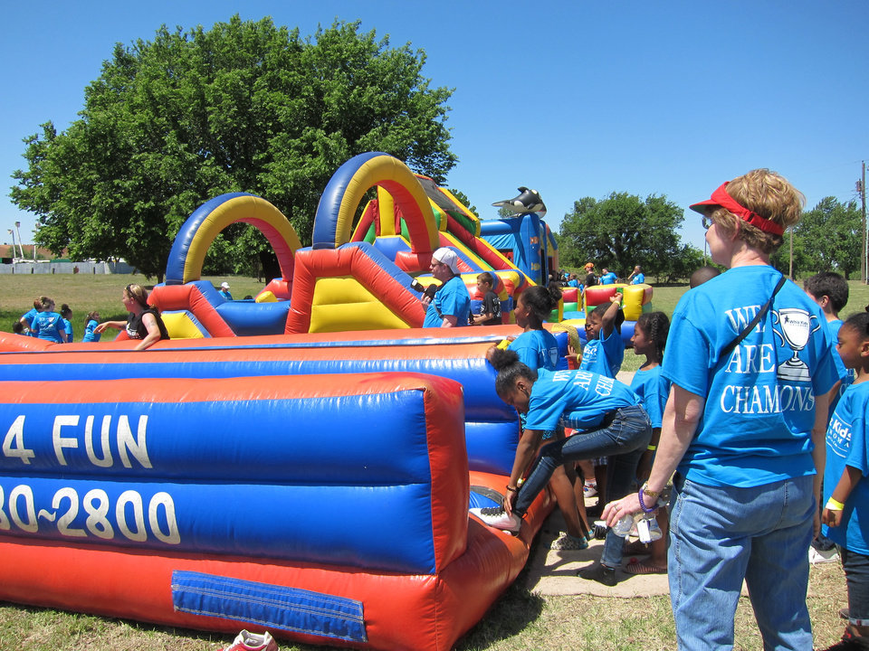 "Photo -  Inflatables were a big draw for children who attended the recent Whiz Kids ""Spring Fling"" event at Crystal Lake. Photo by Carla Hinton, The Oklahoman"