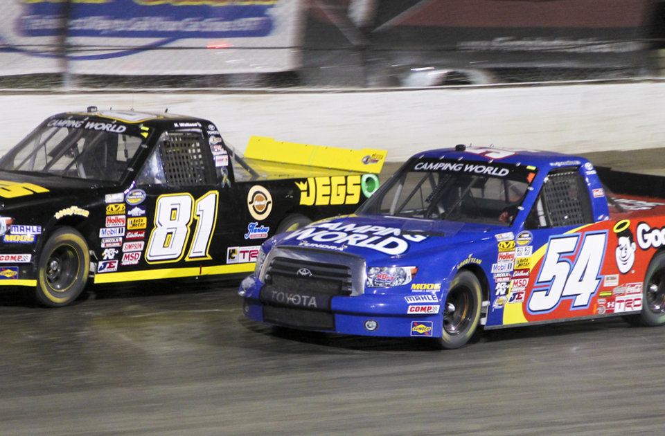 Photo - Kenny Wallace, left, and Darrell Wallace Jr. race during the NASCAR Truck Series auto race Wednesday, July 24, 2013, on the dirt at Eldora Speedway in Rossburg, Ohio. (AP Photo/Dayton Daily News, Greg Lynch) LOCAL PRINT OUT AND LOCAL TV OUT (WKEF, WRGT, WDTN)