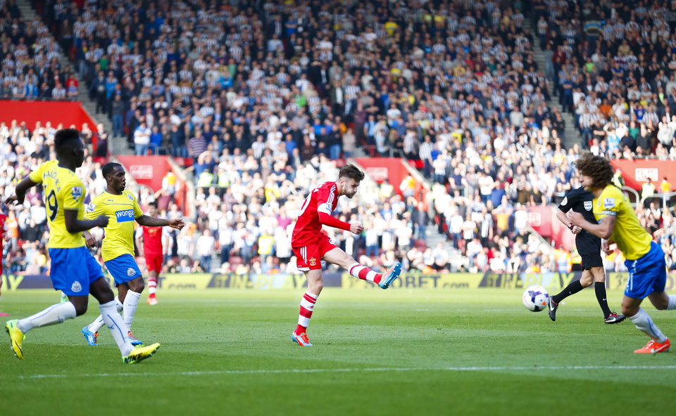 Photo - Southampton's Adam Lallana, center, shoots to score his team's third goal during their English Premier League soccer match at St Mary's, Southampton, England, Saturday, March 29, 2014. (AP Photo/Chris Ison, PA Wire)    UNITED KINGDOM OUT    -    NO SALES   -   NO ARCHIVES