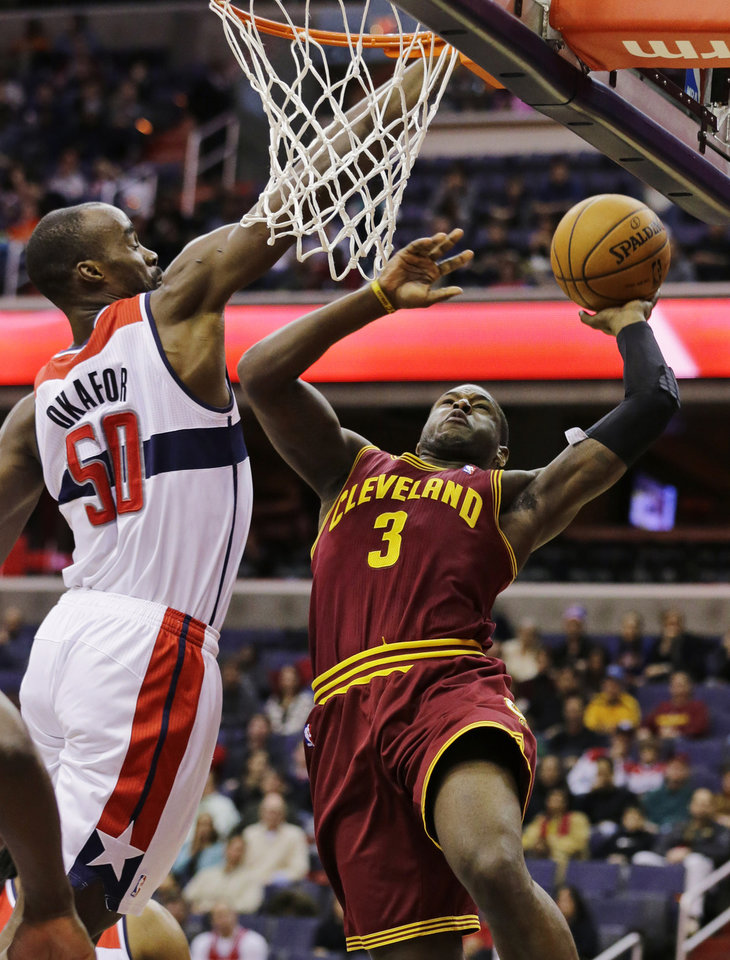 Photo - Cleveland Cavaliers guard Dion Waiters (3) shoots over Washington Wizards center Emeka Okafor (50) in the first half of an NBA basketball game, Wednesday, Dec. 26, 2012, in Washington. (AP Photo/Alex Brandon)