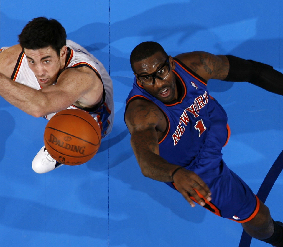 Oklahoma City\'s Nick Collison (4) goes for the ball beside New York\'s Amar\'e Stoudemire (1) during the NBA game between the Oklahoma City Thunder and the New York Knicks at Chesapeake Energy Arena in Oklahoma CIty, Saturday, Jan. 14, 2012. Photo by Bryan Terry, The Oklahoman