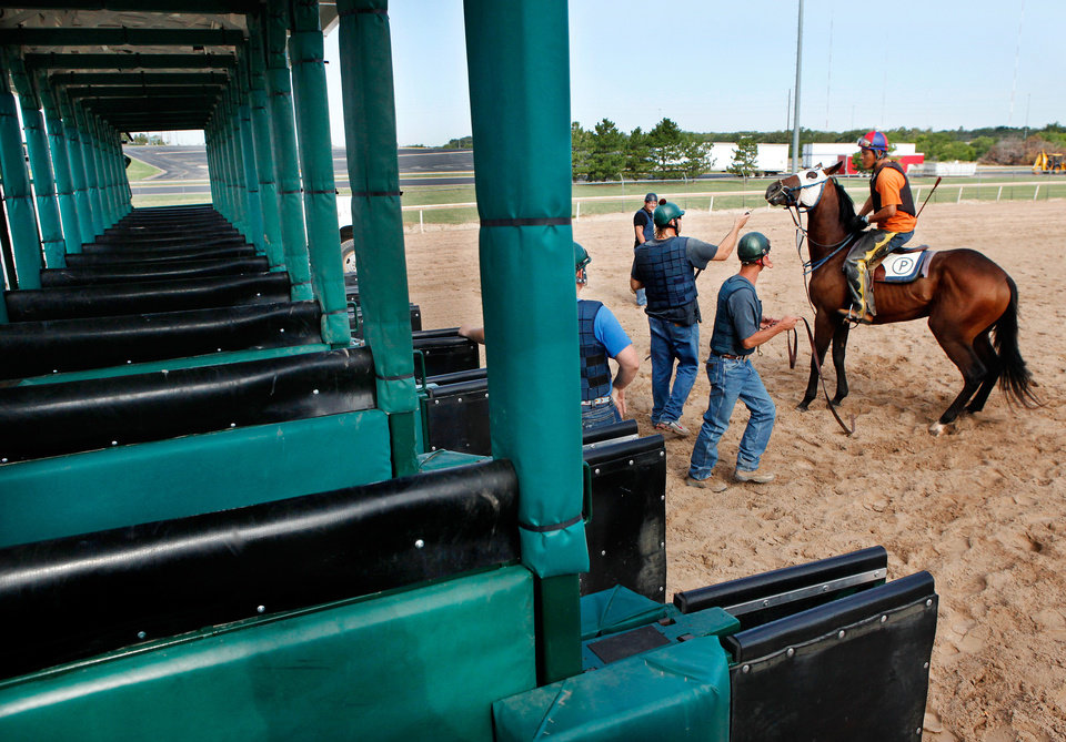 Photo - HORSE RACING: Men who work on the gate crew at Remington Park Racetrack on Tuesday morning,  Aug. 16, 2011.  by Jim Beckel, The Oklahoman.  ORG XMIT: KOD